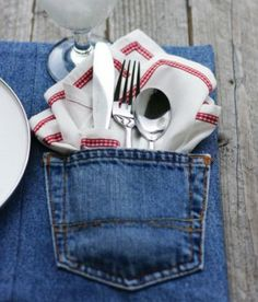 spoon, fork, and napkin in jeans pocket on the table under the glass and plate!