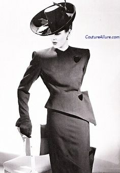 Costume designer Gilbert 'Adrian' was responsible for many iconic MGM costumes, his signature look was big shoulder pads and a nipped in waist.
