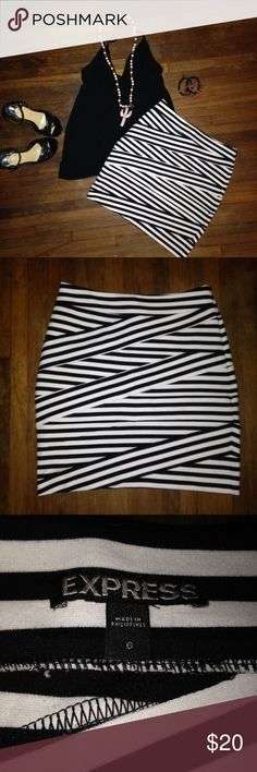 Express Stripe Stretchy Pencil Skirt Like new condition. Express black and white striped bandage pencil skirt. Super super stretchy material with side zip closure.   Where to work or out with the girls. Easy to take from day to night. Express Skirts Pencil