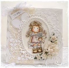 Beautiful card.......love the lacy dies and soft colors with this sweet Tilda image