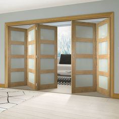 Thrufold Coventry Shaker Oak 3+2 Folding Door - Frosted Glass - Unfinished - Lifestyle Image. #glazed #foldingdoors