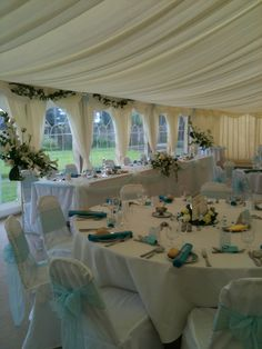 http://www.allwrappedupevents.co.uk/ weddings chair covers vintage crockery hire marquee set up aqua