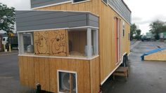 Tiny Giant House on Wheels with Onboard Chicken Coop and Solar Setup