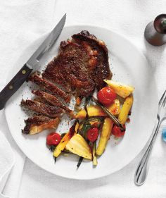 Steak With Roasted Parsnips, Tomatoes, and Scallions | Need some quick dinner ideas? Try one of these speedy recipes that take just 15 minutes or less of hands-on work.