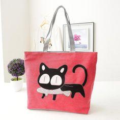 Sac à main pour femme en tissu rose avec image de chat cartoon noir qui mange un petit poisson. Sac à man assez drôle et humoristique :)