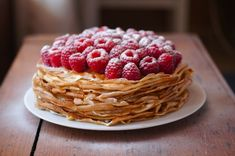 16 Luscious Crêpe Recipes To Celebrate Pancake Day - Shown is Dusky Caramel and Raspberry Crêpe Cake