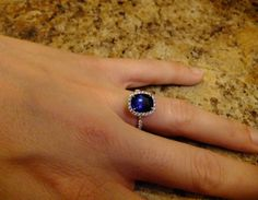 Another cushion cut sapphire ring with halo...  I do believe it's Harry Winston.