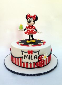 This Superb Minnie Mouse Birthday Cake has Minnie Mouse holding a green Birthday present in her hand. The cake has red and whites stripes on the bottom of this single layer Disney Birthday Cake. There are white daisies on the cake. Bolo Da Minnie Mouse, Mickey And Minnie Cake, Bolo Mickey, Minnie Mouse Birthday Cakes, Custom Birthday Cakes, Mickey Cakes, Birthday Cake Girls, Happy Birthday, Mini Mouse Cake