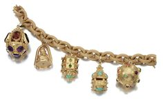GEM-SET CHARM BRACELET Designed as a textured cable link bracelet suspending five charms each set with various gemstones and highlighted with beading and engraved patterns, length approximately 170mm