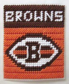 Cleveland Browns tissue box cover in plastic canvas. For inspiration only.no pattern. Plastic Canvas Coasters, Plastic Canvas Ornaments, Plastic Canvas Tissue Boxes, Plastic Canvas Crafts, Plastic Canvas Patterns, Cross Stitch Needles, Cross Stitch Patterns, Canvas Designs, Canvas Ideas
