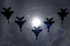 A flight of F-15C Eagles from the 44th Fighter Squadron, Kadena Air Base, flies during a total solar eclipse over the island of Okinawa, Japan July 22, 2009. U.S. Air Force photo by Airman 1st Class Chad Warren