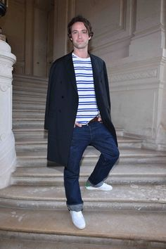 Louis Marie de Castelbajac wearing a Valentino coat from the Fall/Winter 2016-17 Collection to the Valentino Men's Spring/Summer 2017 fashion show on June 22nd 2016.