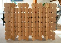 Cardboard circles fit together to make an endless array of room divider shapes and sizes.