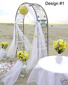 Hanging floral, tulle & two floral stands which can then be placed inside for the reception
