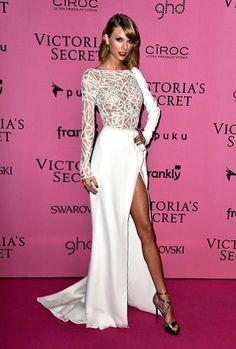 Taylor shined at tonight's post show event wearing Zuhair Murad's long sleeve white silk evening gown with crystal embellished sheer bodice and sleeve from the Fall/Winter 2014 Couture collection