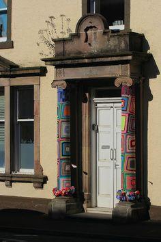 Yarn bombed pillars at 7 Castle Street, recipient of Rothesay THI regeneration funding
