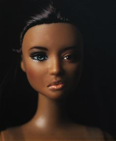 "Exposing problematic beauty standards using Barbie dolls. Photographer Sheila Pree Bright explores the complexities of racial identity in her work. In her Plastic Bodies series, which developed in 2003, Bright contrasts fragmented bodies of multicultural women with the dolls. The blend of human and artificial features is unsettling and helps make the ""global assimilation of cultures, ethnicities, and loss of personal identity many women of color experience as a result"" painfully obvious."
