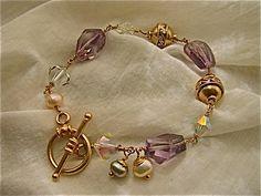 14k gold fill  wire work amethyst nugget and Swarovski aurora borealis bracelet