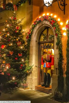 A lifesized soldier nutcracker stands in a decorated doorway of the Käthe Wohlfahrt store in Rothenburg ob der Tauber, next to a Christmas tree. German Christmas Markets, Christmas Town, Christmas Scenes, Noel Christmas, Winter Christmas, All I Want For Christmas, Merry Little Christmas, Beautiful Christmas, Christmas Wonderland