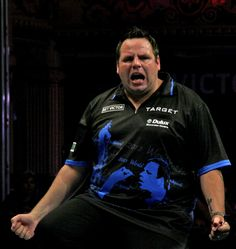 Adrian Lewis drops to his knees after landing the winning double to defeat Michael van Gerwen in an epic semi-final