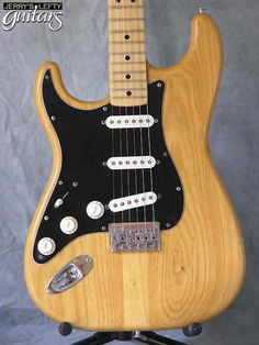 lefty guitars | close-up view left hand guitar Fender Stratocaster natural gloss