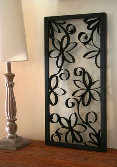 Framed Paper Rolls Flower Decoration. This is pretty cool.