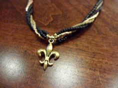 Black and Gold Fleur De Lis Necklace by CourtNola on Etsy, $25.00