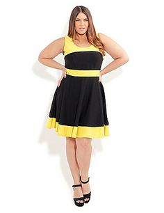 Work your curves & show your style in this gorgeous A - line Spliced Skater Dress. This ponte style is a super stretch fit that features invisible back zip closure. sonsi.com
