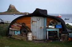 Fishing vessels no longer fit for the sea make stunning rustic roofs for storage sheds in the UK. Already water-tight, the vessels are flipped upside down and sliced on one side to allow installation of a door.