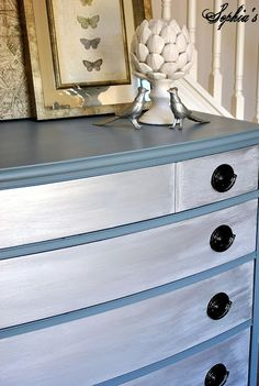"Slate Blue with Silver Metallic paint on the drawer fronts. Top off the silver with white glaze to achieve a ""Zinc"" like finish. Beautiful"