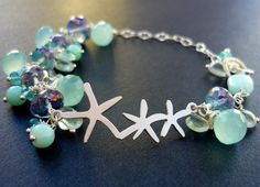 Bracelet Charm Gemstone Starfish Opal Mystic by baublesforbellas ............ Just a really cool piece of jewelry