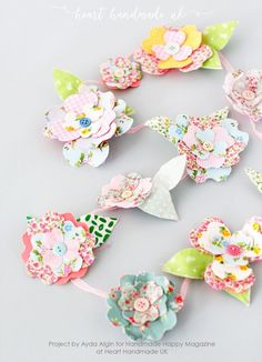 A gorgeous garland made of pretty bendy fabric flowers - How To Make Fabulous Bendy Flowers For LOADS Of Crafty Projects!