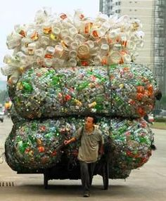A Chinese man transports plastic bottles and containers for recycling in Haikou, the capital of China's southern Hainan province. Plastic Pollution, Wise Owl, People Of The World, Plastic Bottles, Water Bottles, Empty Bottles, Belle Photo, Mother Earth, Transportation