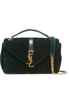 Saint Laurent's classic 'Monogramme' bag is reworked this season in plush emerald velvet with a quilted finish. It's accented with the brand's instantly recognizable 'YSL' plaque and polished gold chain shoulder straps. The twill-lined interior will perfectly house your cell, wallet and cosmetics case.