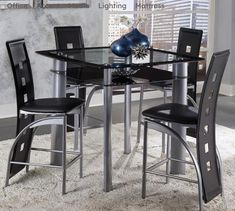 Latitude Run Ultra-modern styling is executed flawlessly in the design of this Pub Table Set. This set immediately draws your attention and provides stylistic drama to the casual dining group. Dining Table Setting, Pub Table Sets, Counter Height Dining Sets, Counter Height Dining Table, Breakfast Nook Dining Set, Dining Table, Counter Height Dining Table Set, Table, Metal Table Top