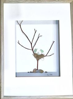 Genuine Sea Glass Art Bird Family in Shadow Box FrameArt Modern Wall Art Abstract Contemporary Signed. This signed original pebble art is made by me, Susi Uhl. The art is a unique style made of genuine sea glass collected by me and real birds nest material from an empty nest in my back yard. This would be a perfect gift for a baby shower or baby gift. The art comes in a 12 x 16 Silver-Grey Shadow box with matting. The overall frame size is 13 x 17 x 1.75. Inside matting measures 8 x 10 All…