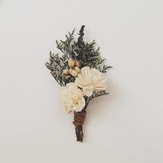 Planning a rustic, vintage, or woodland inspired wedding? Take a look at these 25 Rustic Boutonniere Ideas. MountainModernLife.com