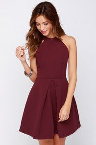 As Seen On Becky of Cella Jane blog! It's time for you to get a dress that has the same amount of style and personality that you do, and the Keepsake Adore You Burgundy Dress fits the bill flawlessly! This thick, woven poly dress has a smooth, satiny feel, and an exceptional fit in a rich burgundy color. A halter neckline and darts give the bodice a bodycon fit, while a slit back (with button closures) tops a triangle cutout. Flared skirt is amplified by a front box pleat. Hidden back…
