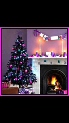 Loving this black tree with colorful ornaments