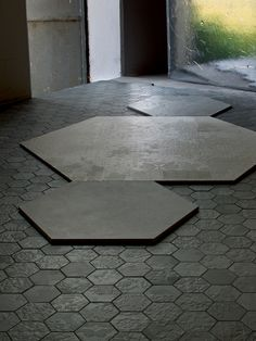 Déchirer is a series of large format through-body porcelain tiles designed by Patricia Urquiola. Déchirer is notable for its patterns and textures made possible through the technology used in production. The series won the 2009 Best of NeoCon Silver Award in the Hard Surface category. It also won the Elle Deco International Design Awards