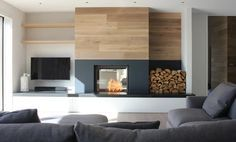 This beautiful home in Rock uses it's Stuv double sided fire to heat both the large lounge and dining room.  See this and more http://www.kernowfires.co.uk/wood-burning-stove-installation-cornwall/  #stuv #double #sided #stove #woodburner #log #store #installation #inset #modern #contemporary #rock #cornish #coast #lounge #living #dining #room #kernowfires #wadebridge #redruth #cornwall