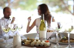 A sunny day deserves a great lunch with excellent wine at Ithaki terrace. Ithaki Restaurant, Athens, Greece.