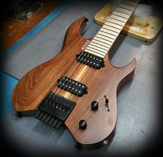 Kiesel Guitars Carvin Guitars  V7 (Vader Headless series) with a walnut body in a satin finish
