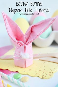 Complete your Easter brunch table setting with these adorable and easy to make Easter Bunny Napkins.  This step-by-step tutorial will show you how to fold your paper napkins into cute little bunnies that your guest will love! #diy #easter #eastercrafts #tutorial #easterbunny #crafts