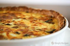 Mushroom Quiche ~ Mushroom quiche with all-butter pie crust filled and baked with mixture of egg, cream, milk, sauteed mushrooms and shallots. ~ SimplyRecipes.com