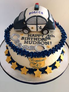 #policecake #carcake Sugar police car with sugar badge, handcuffs and lots of stars.  We support our men/women in blue!