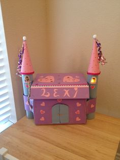 Valentine's Day box / Castle  -Cards go in castle doors / over sized cards go in top. Rapunzel mini doll can be taken in & out of towers for pretend play. Battery operated candle in tower.