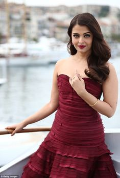 So glam: The 41-year-old actress wowed in a ruby red strapless gown which showed off her s...
