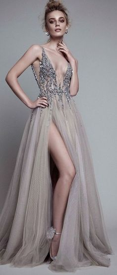 Featured Wedding Dress: Berta; Glamorous silver embellished v-neck bodice wedding dress with thigh high slit tulle skirt;
