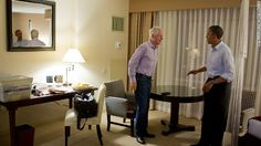 President Barack Obama talks with former President Bill Clinton at the DoubleTree Downtown Orlando Hotel in Orlando, Florida, on Oct. 28, 2012.